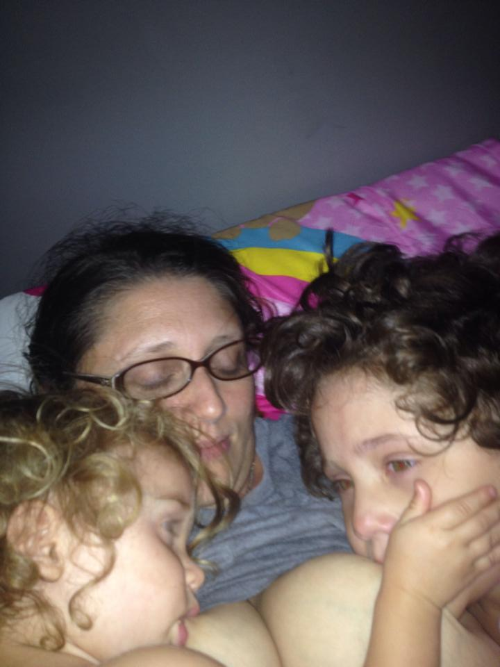 Nursing my two-year-old and four-year-old daughters to sleep. - Lea King