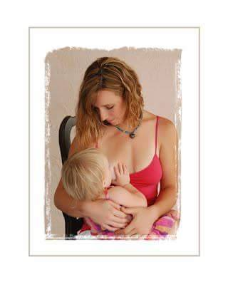 Nursing my now 5 year old. She was just shy of 18 months in this picture. Our nursing relationship lasted another year after this. -Chelsea Bossory