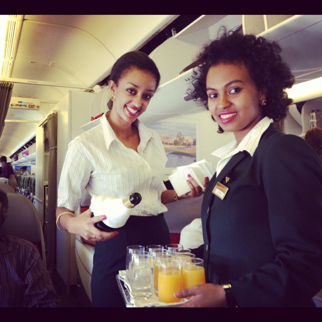 Ethiopian Airlines flight attendants making us mimosas. (And yes, their entire crew was this attractive.)