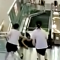 Mother saves baby moments before she falls in fatal escalator accident