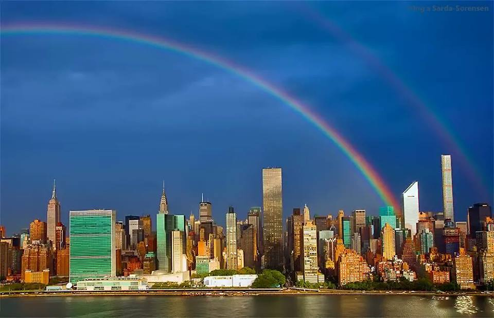 Double rainbow seen over the new World Trade Centre and memorial one day before 14th anniversary of the attacks.