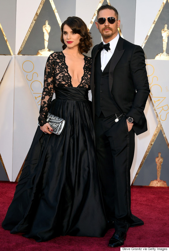 HOLLYWOOD, CA - FEBRUARY 28:  Actor Tom Hardy (R) and Charlotte Riley attend the 88th Annual Academy Awards at Hollywood & Highland Center on February 28, 2016 in Hollywood, California.  (Photo by Steve Granitz/WireImage)